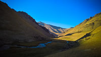 Sunset view to Tash-Rabat river and valley in Naryn province, Kyrgyzstan
