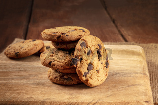 Chocolate chip cookies, gluten free, a close-up of a stack on a dark rustic background