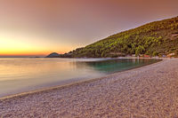The sunset at the beach Panormos of Skopelos, Greece