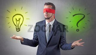 Businessman with idea versus question concept