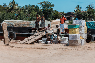 Malagasy workers on main street of Maroantsetra, Madagascar