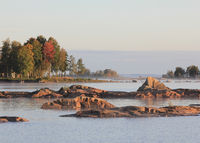 Colourful trees and rock formation at the shore of Lake Vanern.