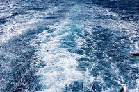 Boat Wave ocean trace on blue sea Red Sea Seashore Egypt background.