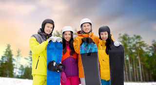 happy friends in helmets with snowboards outdoors