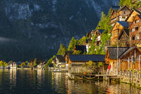 Wooden houses of the Hallstatt village in the sunrise light