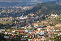 small village / town  in green valley landscape, aerial view -