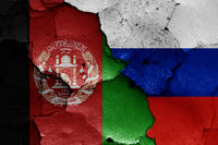 flags of Afghanistan and Russia painted on cracked wall