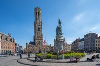 The Belfry of Bruges with market square in Bruges, Belgium.