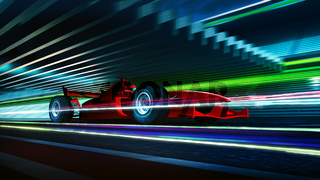 Side view fast moving motion blur red race car and driver with light trail effect
