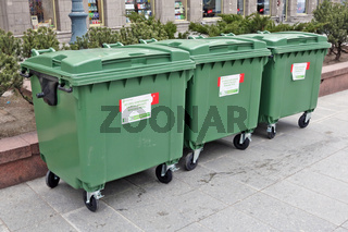 Public plastic green waste garbage containers  of the company Ecoservice on the streets