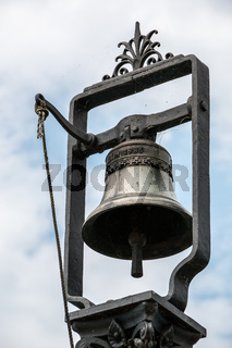 Bell made of steel at the harbor