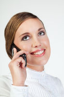 Portrait of a smiling young woman speaking on mobile phone