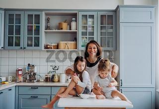 Happy family having fun in the kitchen