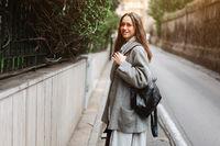 Beautiful young girl on a narrow street.
