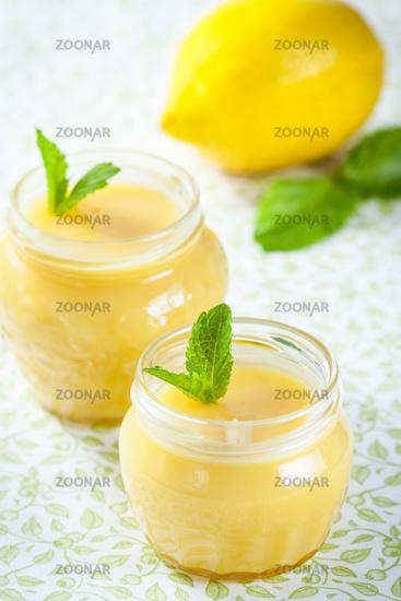 Homemade lemon curd with fresh lemons