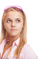 Beautiful blonde young woman in pink shirt close-up