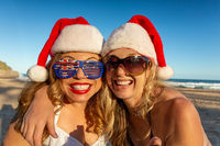 Happy women on the beach at Christmas