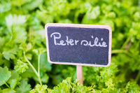 Parsley (german: Petersilie) sign closeup on food market