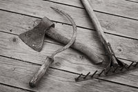 The ax, sickle and rake are the old hand tools