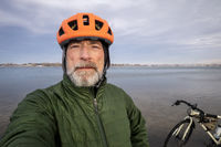 senior male dressed for winter biking