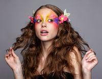 Female with fashion feather eyelashes make-up