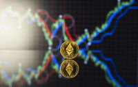 Bitcoins and virtual money concept. Gold ethereum with chart of growing and falling valuance of a cryptocurrency. Mining or blockchain technology. Mining of bitcoins online bussiness. Trading.