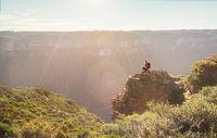 Mountain explorer taking in views from a rock precipice