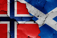 flags of Norway and Scotland painted on cracked wall