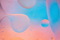 Defocused pastel colored abstract background picture made with oil, water and soap