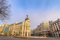 Madrid Spain, city skyline at famous Gran Via shopping street