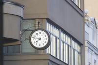 Vintage street clock on the city building