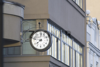 Vintage street clock on the city building