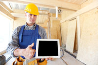 Construction worker holding tablet
