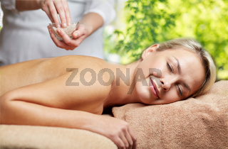 woman having salt massage in spa