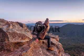 Female with backpack on mountain peak Blue Mountains
