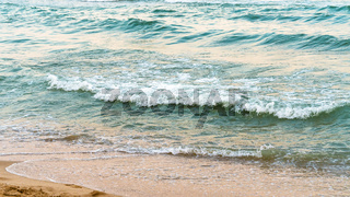 Seaside beach and soft blue sea wave.