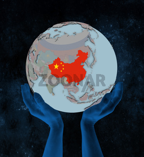 China on political globe in hands