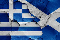 flags of Greece and Scotland painted on cracked wall