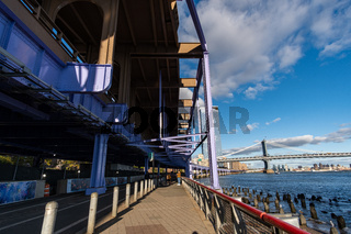Brooklyn Bridge in daylight view from Lower East Side waterfront