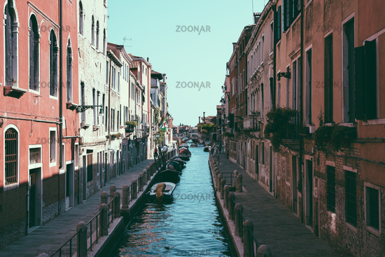 Panoramic view of Venice narrow canal with historical buildings and boat
