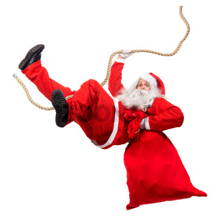 Funny Santa Claus cling on rope with a bag full of x-mas gifts. Falling Santa carry sack with gift box.