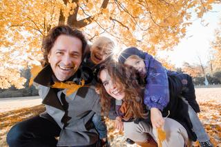 Family hug in autumn park