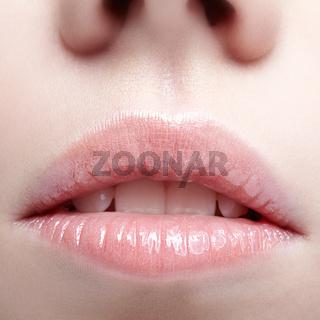 Closeup shot of human female face. Woman with pink plump lips makeup
