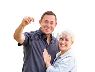 Young Adult Couple Holding New House Keys Isolated On A White Background
