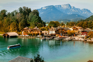 Schönau am Königssee, Germany - September 9, 2018: Electric tourist boats on beautiful lake Konigssee pier Berchtesgaden National Park Bavaria Germany