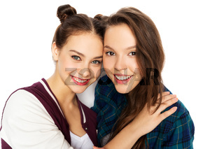 happy smiling pretty teenage girls hugging