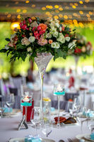 Wedding table decorated with flowers and dishes