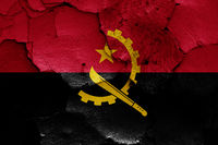 flag of Angola painted on cracked wall
