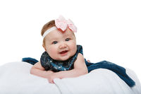 happy beautiful baby girl with bow headband