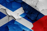 flags of Scotland and Czech Republic painted on cracked wall